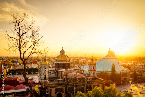 Fotobehang Scenic view at Basilica of Guadalupe with Mexico city skyline at sunset