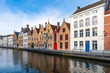 View of a canal and old colorful buildings in Bruges, Belgium