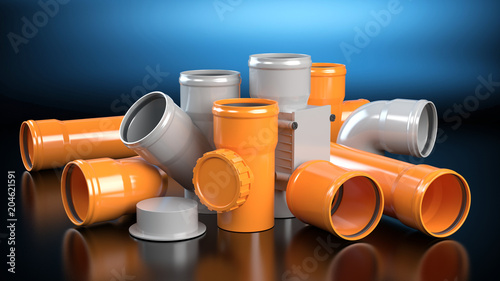 Photo Gray and orange elements for sewer system, dark background