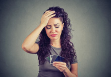 Sad Stressed Woman Looking At Too Many Credit Cards