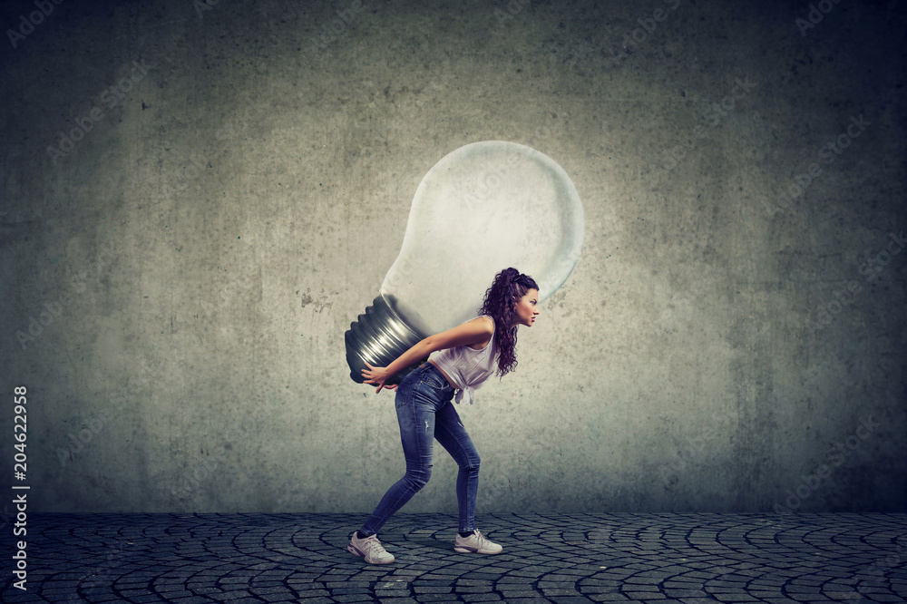 Fototapety, obrazy: woman with business idea light bulb on her back