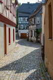 Fototapeta Uliczki - View inside a narrow street between half timbered houses