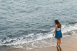 Girl walking into sea Italy
