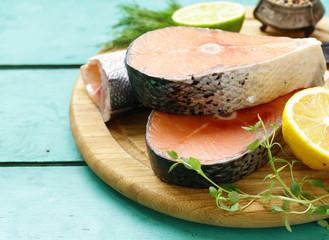 Fototapeta raw fish sea bass and salmon with lemon and herbs