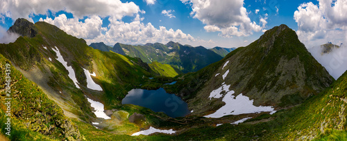 Foto auf Leinwand Gebirge Panorama of Fagaras mountains of Romania. gorgeous landscape with glacier lake Capra, view from above