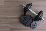black dumbbell on wooden floor in top view