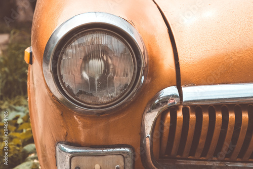Fotografie, Obraz  Headlight on an old car. Vintage toned.
