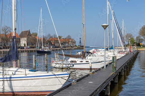 Harbor Dutch city Medemblik with modern yachts moored to wooden jetty Poster
