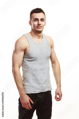 Fotografia  Handsome muscular sporty fit man isolated.