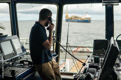 Fotografia  Deck navigation officer on the navigation bridge