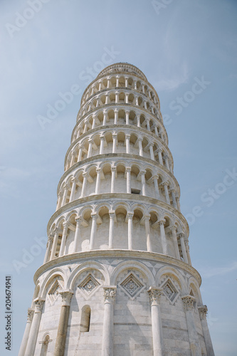 Looking up at the top section of the leaning tower of Pisa, Italy