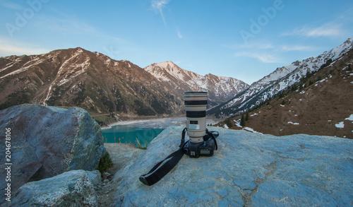 Foto op Aluminium Blauw camera on the mountain lake background