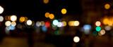 Fototapeta Miasto - Bokeh traffic light at night in the street of a big city