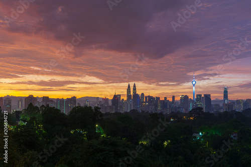 Majestic sunrise over Petronas Twin Towers and surrounded buildings in downtown Kuala Lumpur, Malaysia Poster