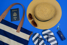 Navy Blue Striped Travel Accessories On A Blue Background