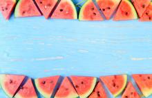 Watermelon Slice On A Blue Rustic Wood