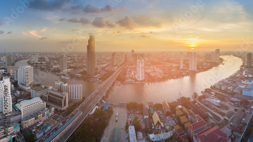 Deurstickers Stad gebouw Panorama city business downtown over river curved with sunset skyline background