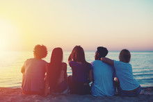 Group Of Happy Friends Relaxing At The Beach