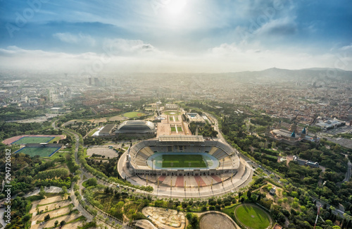 Fototapeta premium Barcelona aerial panorama, Anella Olimpica sport complex on the hill with city skyline , Spain. Sunbeam light