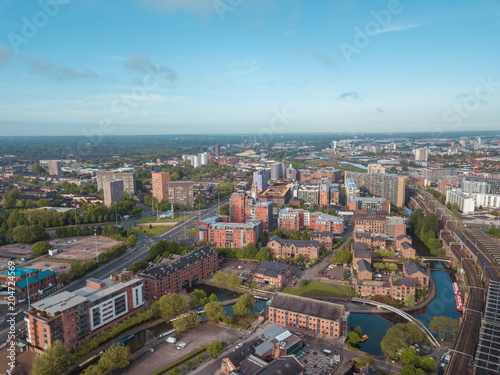 Leinwand Poster Manchester City Centre Drone Aerial View Above Building Work Skyline Construction Blue Sky Summer Beetham Tower Deansgate