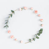 Fototapeta Kwiaty - Flowers composition. Wreath made of rose flowers, eucalyptus branches on pastel gray background. Flat lay, top view, copy space, square