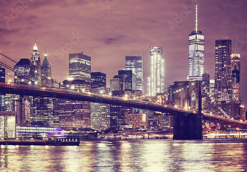 Tuinposter New York City Brooklyn Bridge and Manhattan at night, color toned picture, New York City, USA.