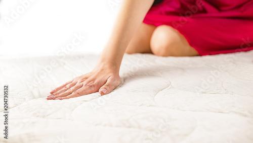 woman on a soft mattress
