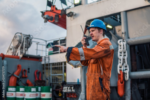 Carta da parati Marine Deck Officer or Chief mate on deck of offshore vessel or ship , wearing PPE personal protective equipment - helmet, coverall