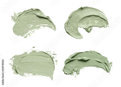 Obraz na plátně Blue clay facial mask smear on white isolated background