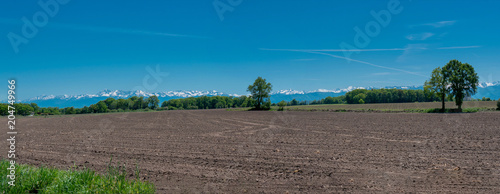 Tuinposter Blauwe jeans countryside landscape with Pyrenees mountain range in the background