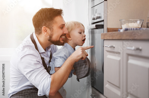 Foto op Plexiglas Koken father with child son prepares meal, bakes cookies.