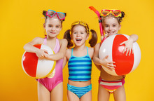Funny Funny Happy Children  Jumping In Swimsuit  Jumping  On Colored Background