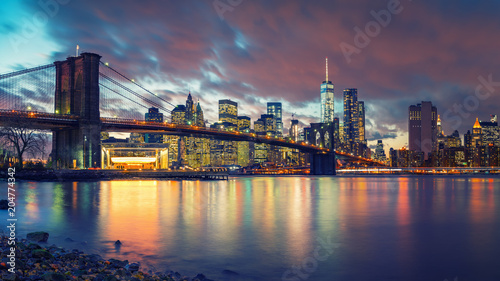 Foto op Canvas New York City Brooklyn bridge and Manhattan after sunset, New York City