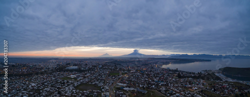 Staande foto Stockholm panoramic aerial photo of Puerto Montt at sunrise, with the volcano Calbuco in the background with volcanic activity, april 2015