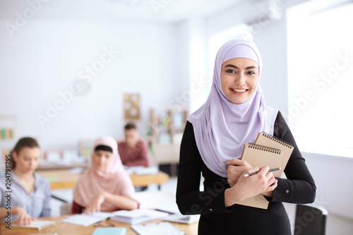 Fotografie, Tablou Muslim student wearing traditional clothes in classroom
