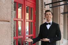 Young Doorman In Elegant Suit ...