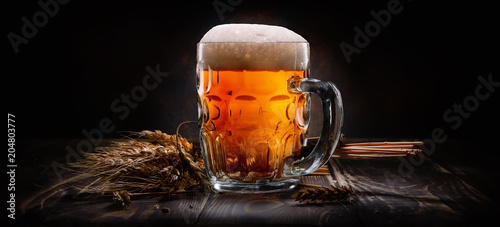 Beer on black background Canvas Print