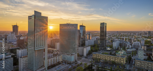 modern skyscrapers in the center of the Polish capital, Warsaw. Sunset sky.