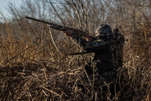 """""""Open Fire"""" - On A Freezing Morning In Canada, A Duck Hunter Aims For An Incoming Flight Of Ducks."""