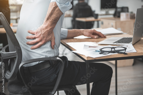 Valokuva  Employer having pain in back