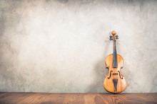 Vintage Antique Violin Near Old Textured Concrete Wall Background. Retro Style Filtered Photo