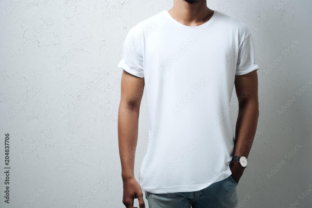 Fototapety, obrazy: Guy wearing white blank t-shirt, grunge wall, horizontal studio close-up