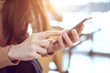 Close up woman hand holding smartphone, She using in mobile applications and multimedia programs. copy space