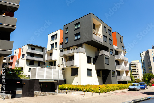 Exterior of a modern apartment buildings on a blue sky ...
