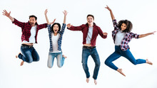 The Four Happy People Jumping On The White Background