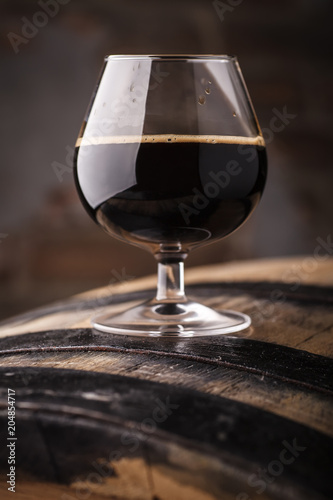Tuinposter Alcohol Glass of barrel aged stout