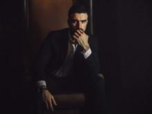 A Handsome Man With A Beard An...