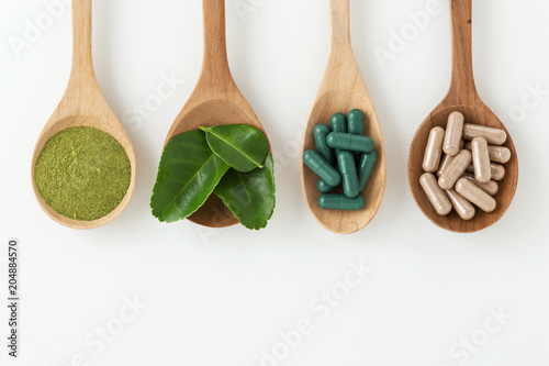 Herbal medicine in spoon on white background Canvas