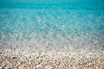 Çakıl taşları ve deniz, arka plan