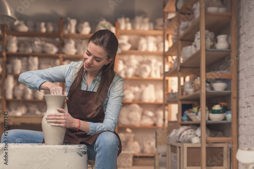 Young girl working on a potter's wheel
